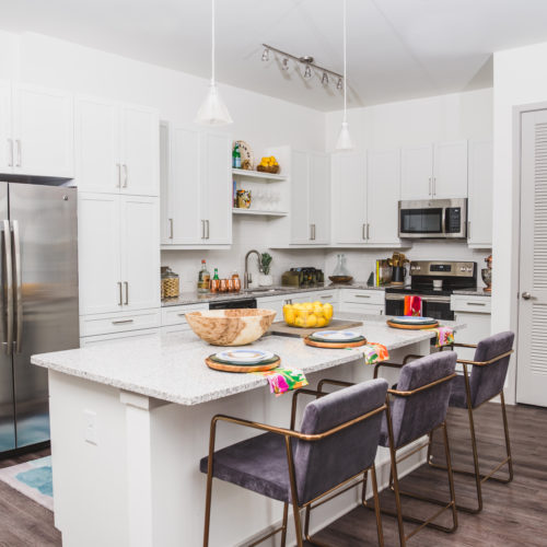 gourmet kitchen featuring stainless steel appliances and pendant lighting - Work and Play in Atlanta