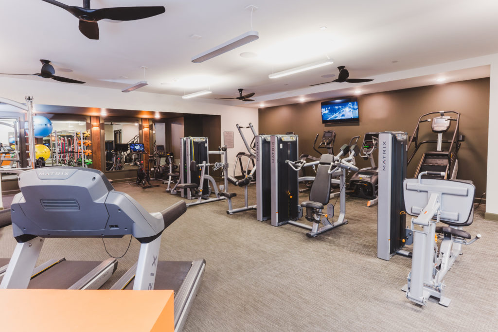 Fitness center cardio & strength equipment at Alexan Buckhead Village - Fitness with Finesse